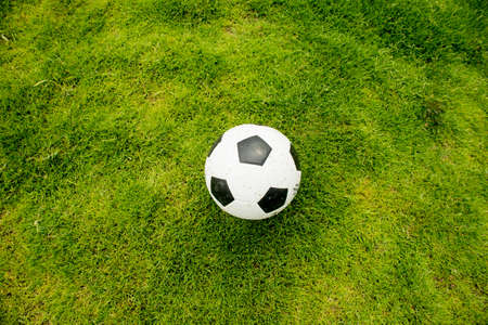 ballsport: Football on the lawn,Close-up of little boy playing football on football pitch Stock Photo