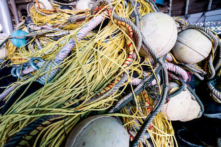 cordage: Abstract background with a pile of fishing nets ready to be cast overboard for a new days fishing