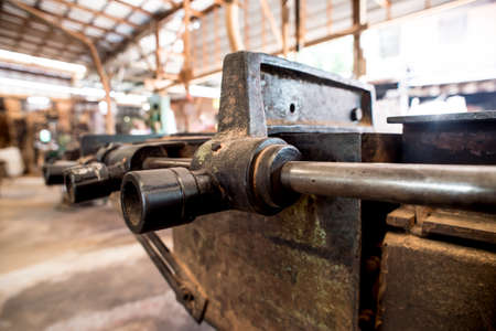 sawing: Milling and sawing machine for processing wood,detail of a rusty historic reciprocating saw,