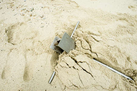 grapnel: Anchor on sand,A metallic anchor fixed in sand