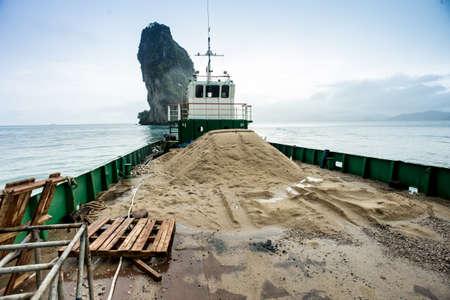 navigating: Loaded barge navigating Stock Photo