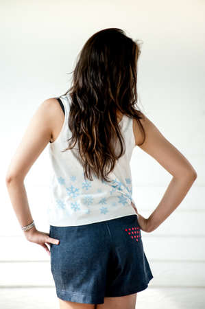 sleeveless: Young woman wearing blank sleeveless t-shirt,Young woman wearing blank vest. wall background.Casual Wear