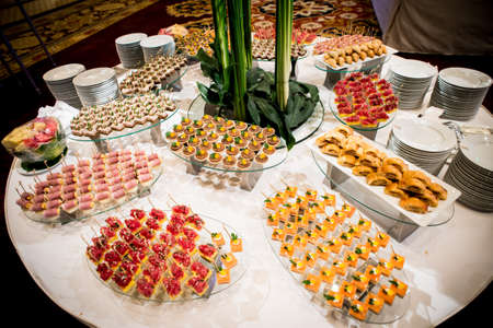 canapes on toothpicks , appetizer, pinchos , spanish food ,delicious finger food, Stock Photo