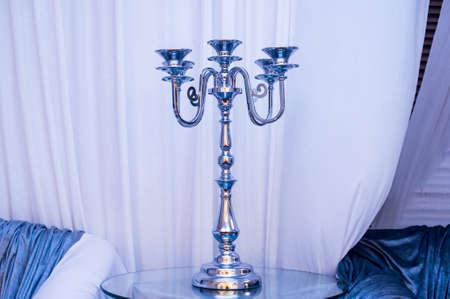 an antique: Antique candlestick