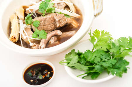 teh: Claypot Cooked Pork Rib Soup With Isolated Background,pork and herbal soup, ba kut teh