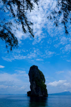 find similar images: Preview Save to a lightbox  Find Similar Images  Share Stock Photo: Dramatic karst mountain island scenery of Railay Krabi Thailand Phranang Beach with tree branch silhouette