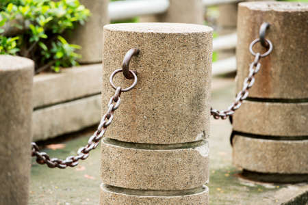 cement pole: cement pole and chain