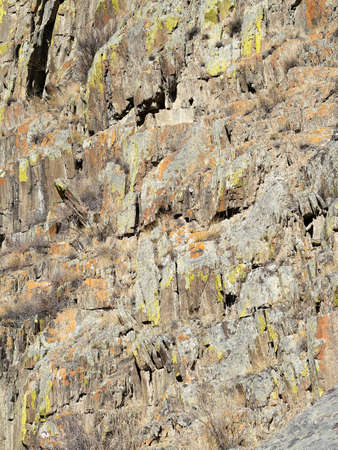 stratified: Stratified structure of the surface of the mountain.