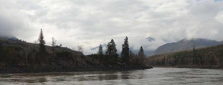 Turbid water of Katun River. Cloudy morning in mountains. Morning light, panorama four shots.