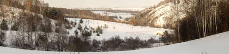 View of the snow-covered valley and plain. Winter, Altai region. Small village in the valley. Roerich place. Altai mountains. Winter, afternoon. Time after snowstorm.