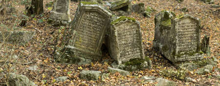Valley of Josaphat in Crimea. Karaite cemetery. Tombstones. Shaped tombstones are diverse: rectangular plate, two-horned, horned, obelisks, stelae. The first burial was made here not earlier XIV-XV centuries.The epitaphs on monuments made in the vast majo