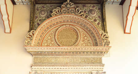 Semicircular pediment. Portal of Iron Doors or Demir Capa Portal. Two full inscription in Arabic script in the frieze: This grand entrance and the magnificent doors were built... Mengli Giray Khan, son of Haji Giray Khan. 909 (1503). Stone carved details