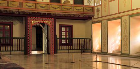 Main entrance of Sofa Hall (a Meeting Hall) of Bakhchisaray Palace, Crimea, Russia. Panorama of three frames, daylight, sun glare.