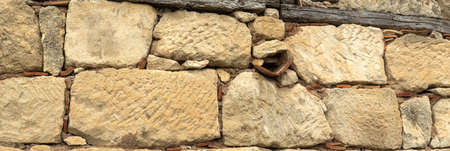 Ancient brickwork. Chufut-Kale wall. Crimea. Bakhchisaray  museum complex, Russia. Panorama of three frames, cloudy dailight, sunny day.