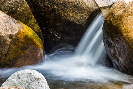 The River in  flowing around a rock.