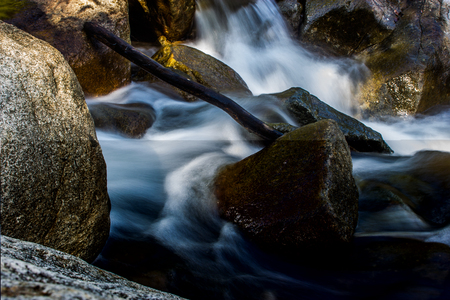 The River in flowing around a rock. Reklamní fotografie