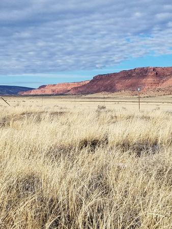 vermilion cliffs prairie grass clouds