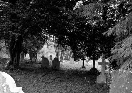 churchyard: A view of some headstones in a church graveyard. Editorial