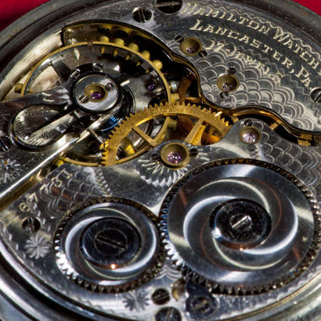 A close-up of the inside of an antique pocket watch. Imagens