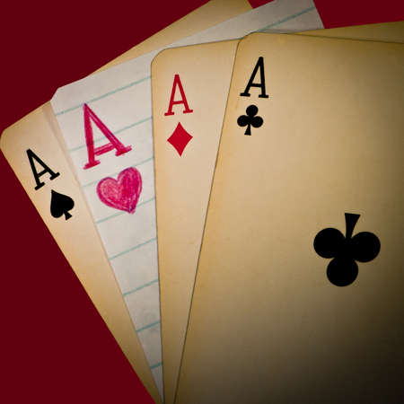deception: A winning hand of four aces - one of them handmade! Stock Photo