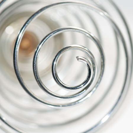 An abstract shot of a metallic whisk.