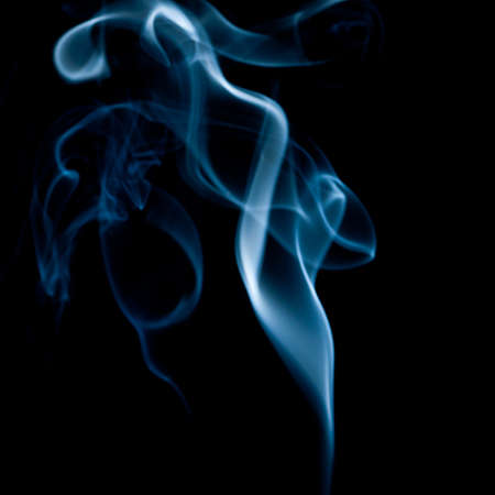 Smoke rising from a lavender incense stick. photo