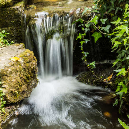 A small waterfall at Top Pond within Exbury Gardens in the New Forest