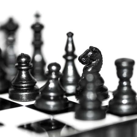 A macro shot of pieces of a travelling chess set Stock Photo - 16529374