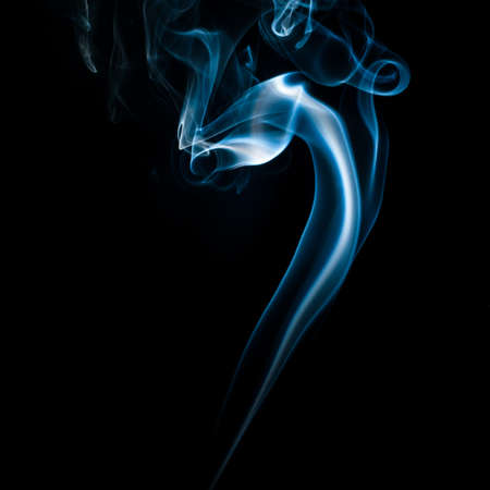 The abstract pattern made from smoke rising from an incense stick. photo