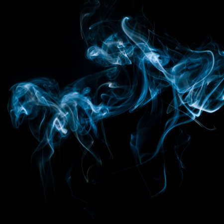 pyromaniac: The abstract pattern made from smoke rising from an incense stick
