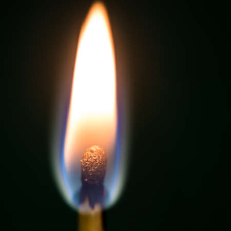 A macro shot of a burning match  photo
