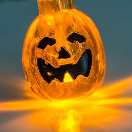 manic: A macro shot of a pumpkin lamp. Stock Photo