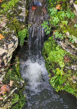 A close-up shot of a small waterfall.