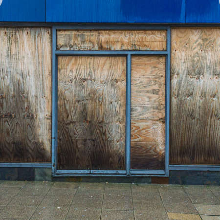 boarded: The boarded up windows of a disused city centre restaurant.