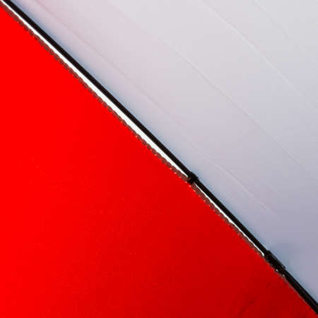 brolly: An abstract macro shot of a red and white umbrella.