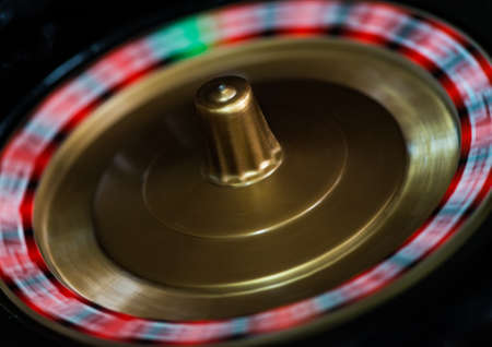 roulette wheel: A macro shot of a spinning toy roulette wheel.
