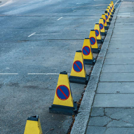 bollards: A row of traffic bollards indicating that there is no waiting in this street. Stock Photo