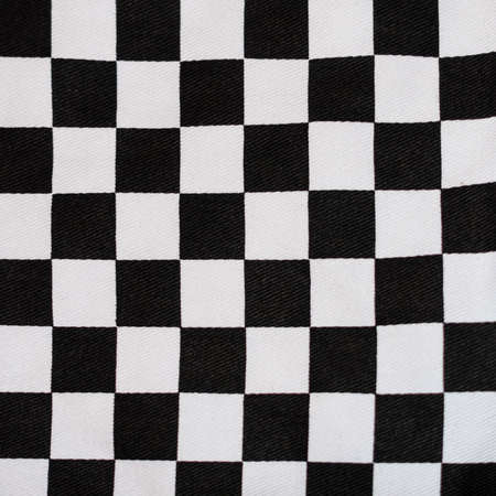 chequer: An abstract macro shot of the black and white pattern of some oven gloves. Stock Photo