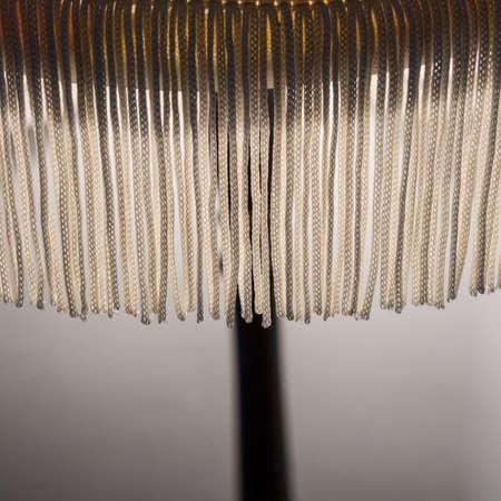 An abstract macro shot of the fringe of a lamp shade.
