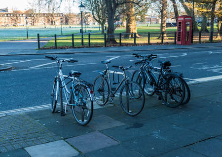 locked up: A shot of some bicycles locked up near a park in Southampton, Hampshire, UK. Stock Photo