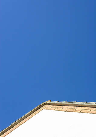 house gable: An abstract shot of the top of a gable end of a house.