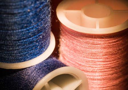 cotton thread: A macro shot of three reels of cotton thread.