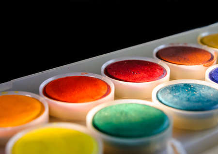 paint palette: A macro shot of a small watercolour paint palette.