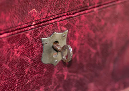 jewellery box: A maco shot of a key situated in a red jewellery box.