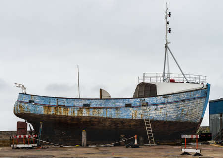 A shot of a boat undergoing restoration work at Hartlepool marina, UK.