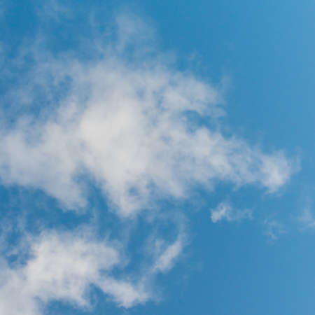 An abstract shot of a cloud in a blue sky that looks a little like a foxes head. Stock Photo