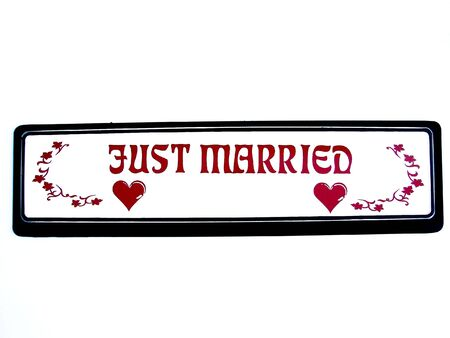 occasions:                            Just married plate written in vinyl stickers for wedding occasions     Stock Photo
