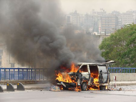 peace risk: burning van  Stock Photo