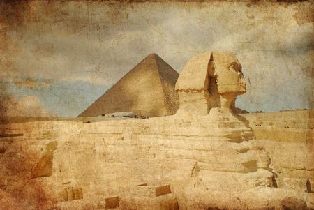 grungy toned texture over pyramids photo