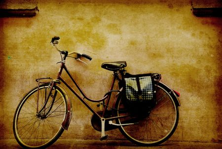 old motorcycle: old retro bicycle against a grungy wall in italy